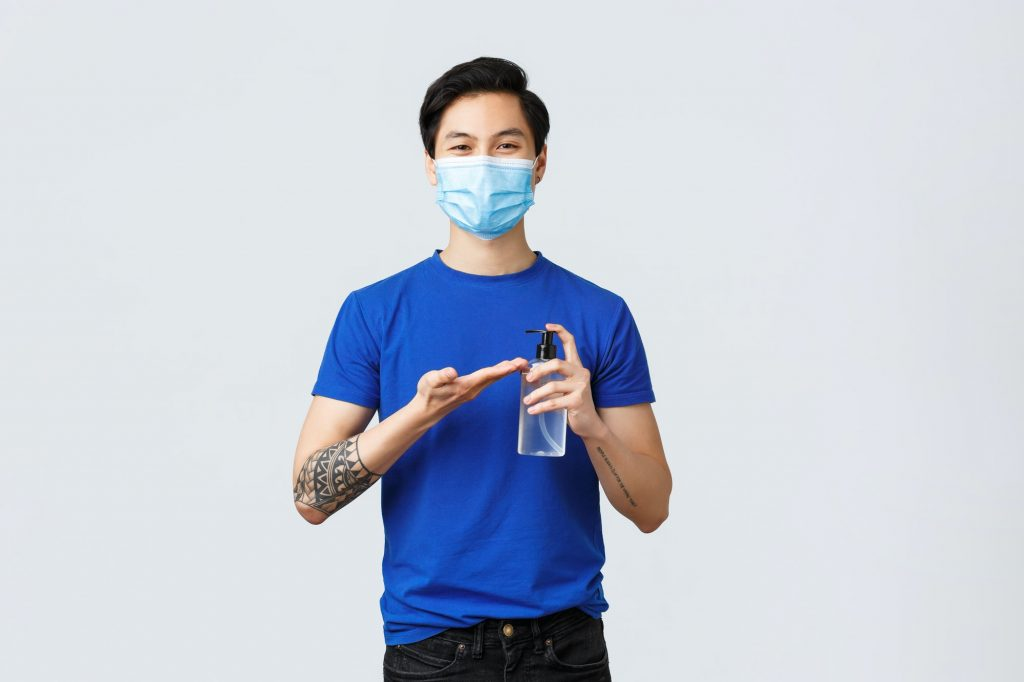 Lifestyle, people different emotions and covid-19 pandemic concept. Smiling handsome asian man in